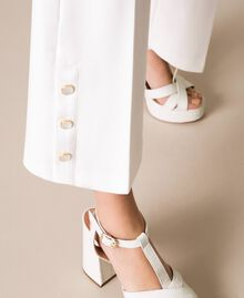 Trousers with frill and pearls Ivory Woman 201TP2103-05