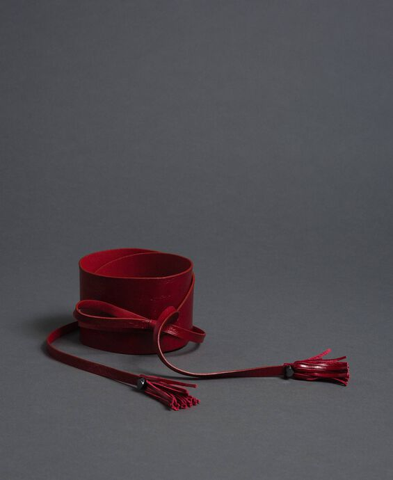 Wide leather belt with strings and tassels