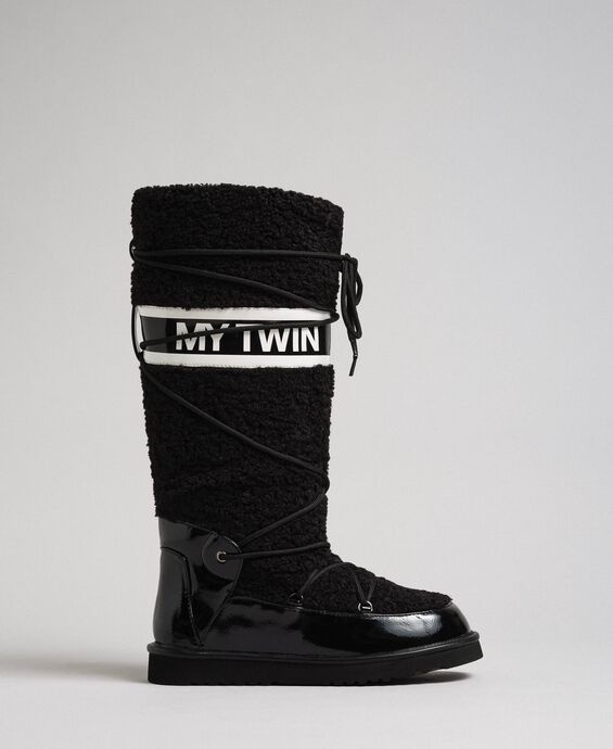 Faux fur and patent leather boots with logo