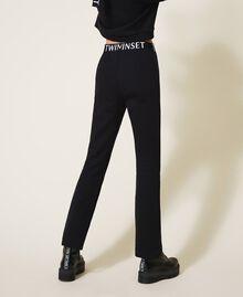 Расклешенные брюки из футера Черный Pебенок 202GJ2812-04
