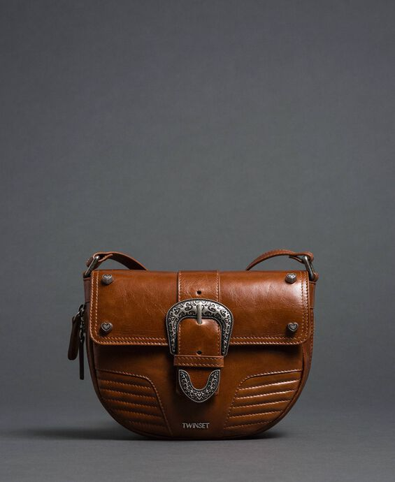 Rebel leather shoulder bag with decorative buckle