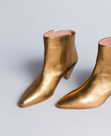 Laminated leather ankle boots Gold Yellow Woman CA8TPA-01