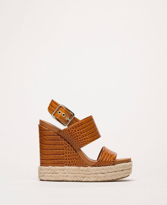Leather sandals with croc print and wedge