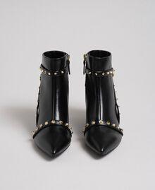 Bottines en similicuir avec clous Noir Femme 192MCT050-05