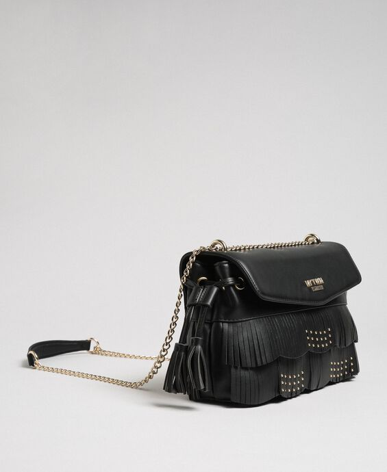 Faux leather shoulder bag with fringes and studs