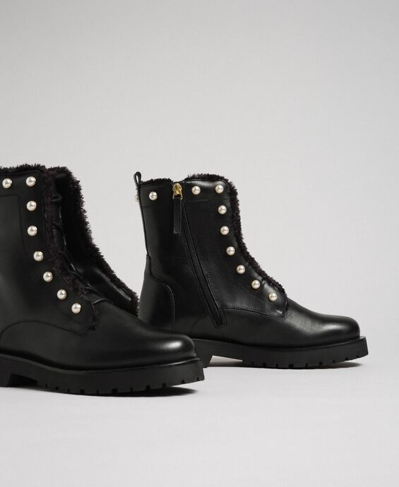 Leather combat boots with pearls