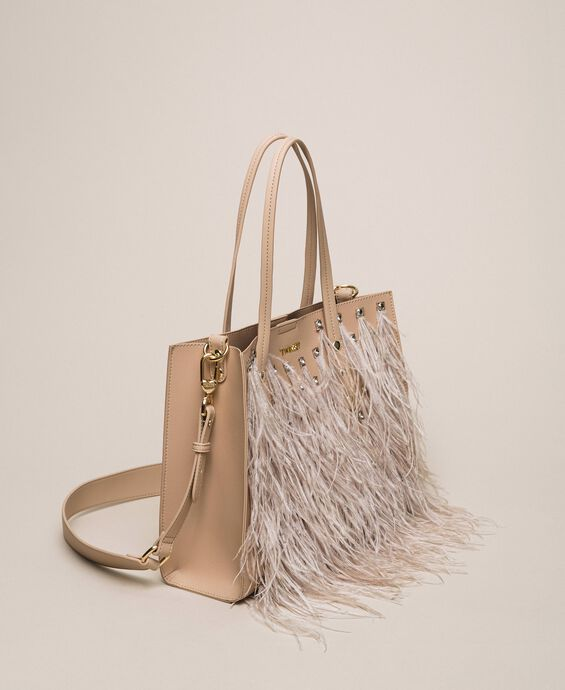 Faux leather shopper with rhinestones and feathers
