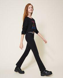 Расклешенные брюки из футера Черный Pебенок 202GJ2812-03