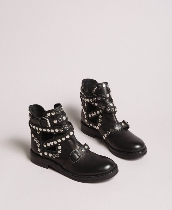 Leather biker boots with straps and studs