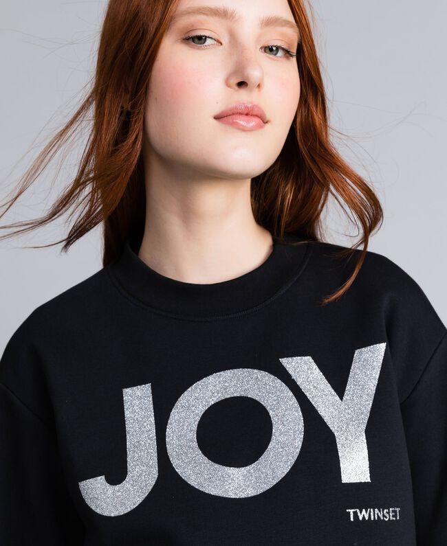 Sweatshirt aus Baumwolle mit Glitter-Print Schwarz Frau QA8TMA-04