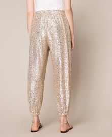 Sequinned joggers Gold Yellow Woman 201LB21GG-04