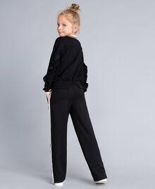 Pantaloni in tessuto tecnico con logo Bicolor Nero / Off White Bambina GA82PP-03