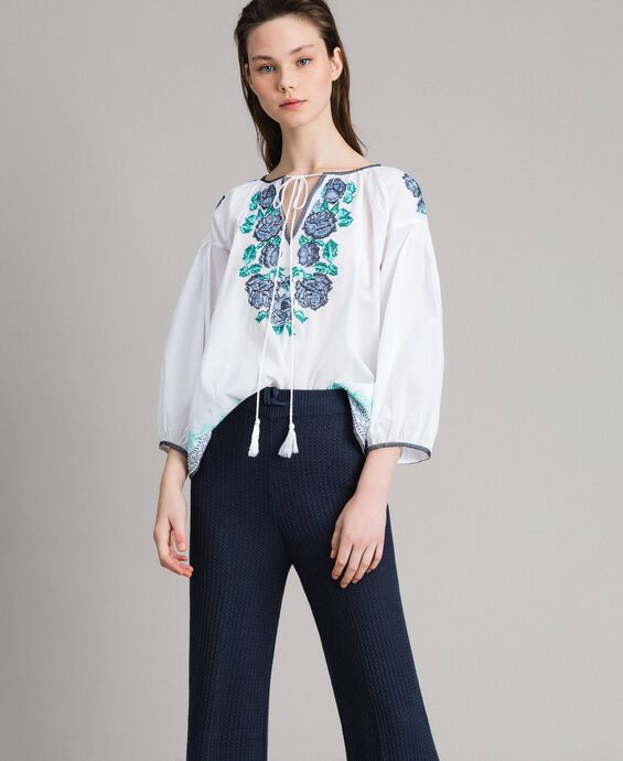 Flounced blouse with cross stitch embroideries