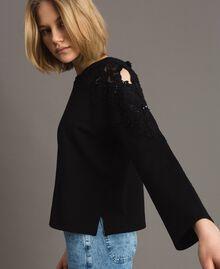 Sweatshirt mit Blumenstickapplikationen Schwarz Frau 191TT2210-02