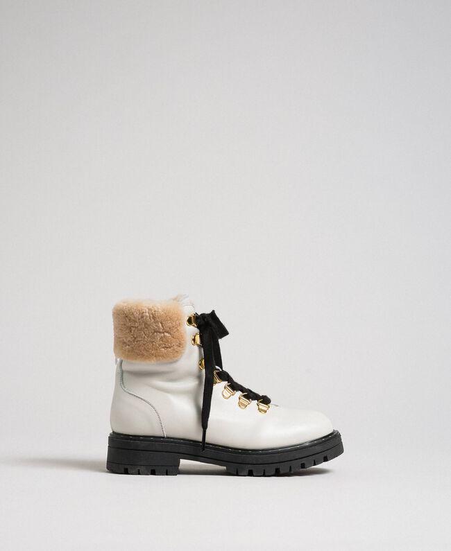 Stiefelette aus Leder mit Wanderschuhschnürung Chantily Kind 192GCJ01C-01
