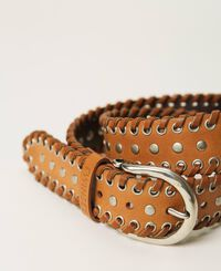 Leather belt with eyelets and studs