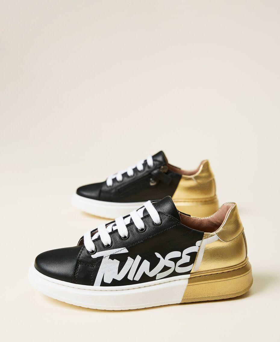 Sneakers de dos colores con logotipo Bicolor Negro / Oro Niño 212GCJ050-01