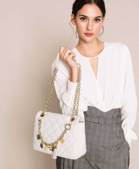 Faux leather shoulder bag with charms