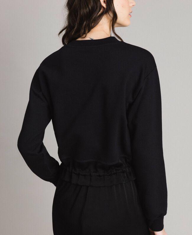 Sweatshirt mit Stickschmetterling Schwarz Frau 191TP2594-03