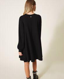 Kleid mit Nieten und Strass Schwarz Frau 202MT2152-03