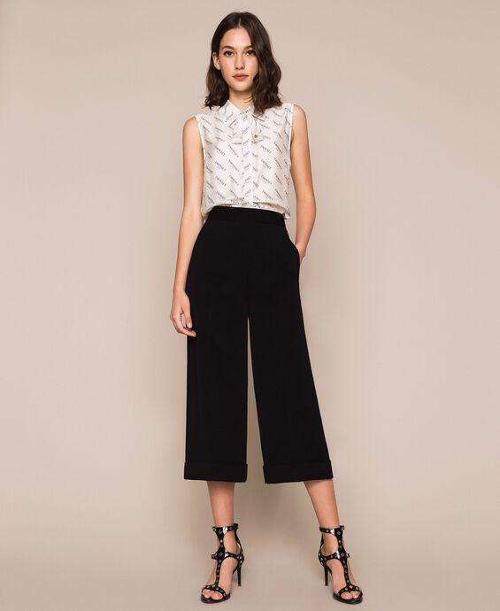 Pantaloni ampi in georgette