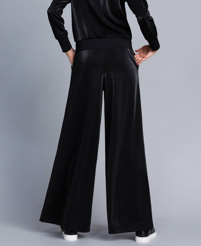Technical fabric palazzo trousers Black Woman IA85CC-03