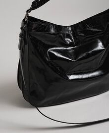 Hobo-Bag aus Leder in Craquelé-Optik mit Nieten Schwarz Frau 192TA7236-04