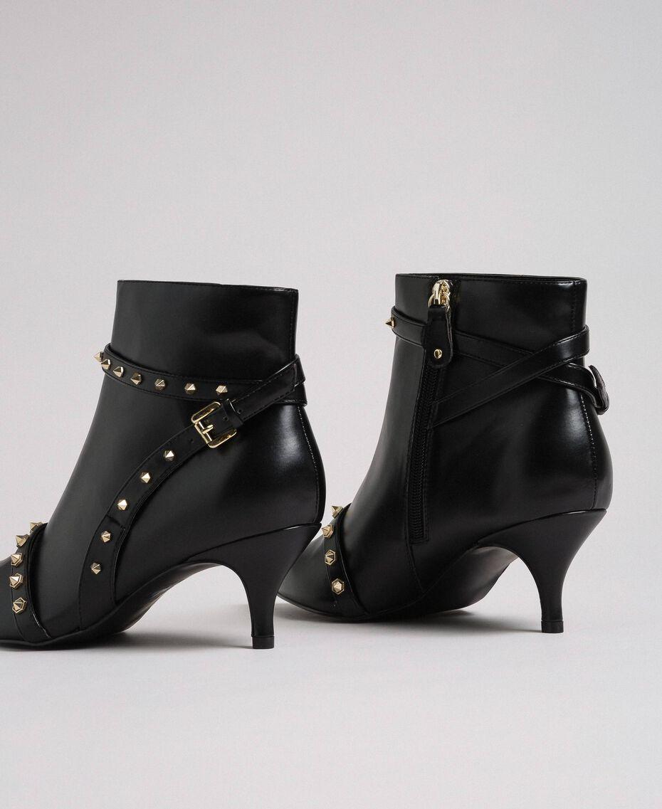 Bottines en similicuir avec clous Noir Femme 192MCT050-02