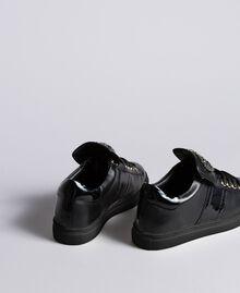 Sneakers aus Leder mit Herzaufnäher Schwarz Frau CA8PB1-03