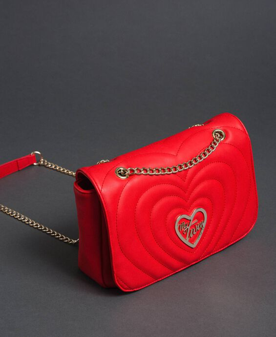 Shoulder bag with quilted hearts