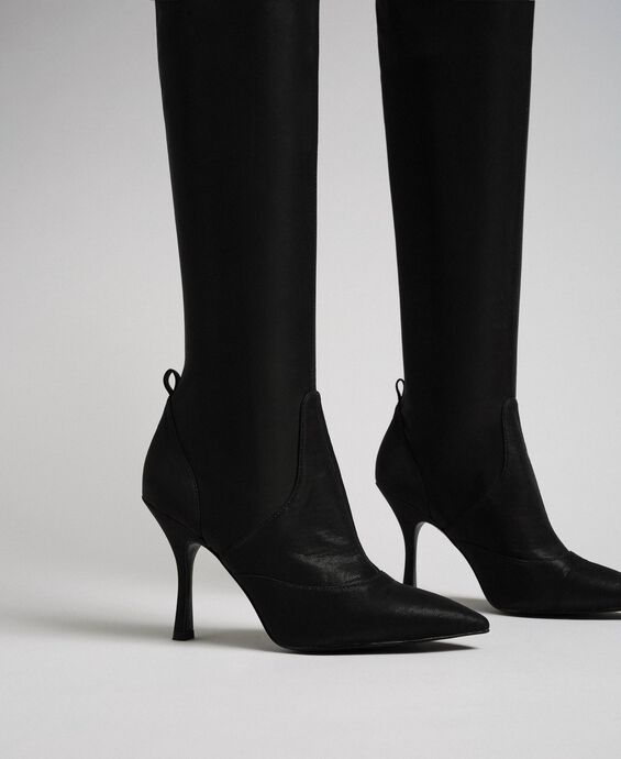 Thigh high boots with stiletto heel