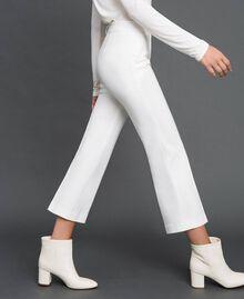 Расклешенные брюки Белый Снег женщина 192TP2092-01
