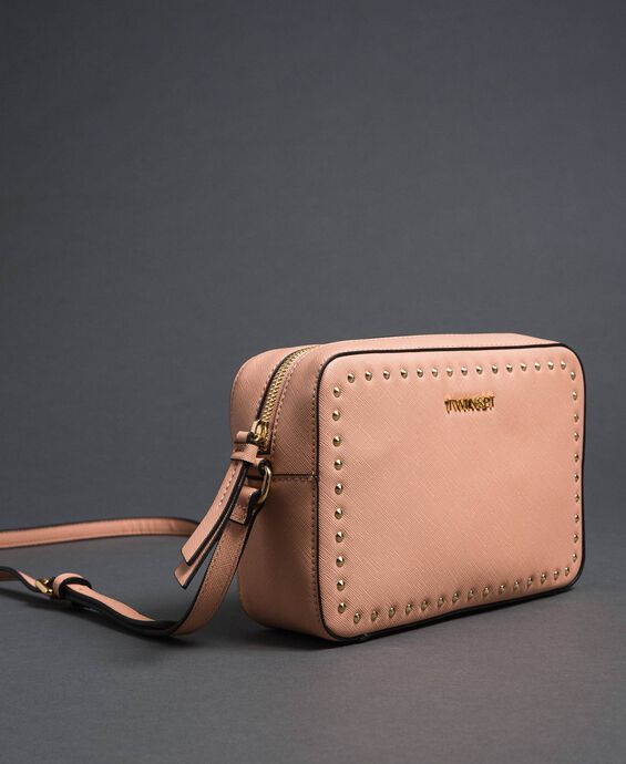 Small faux leather shoulder bag with studs