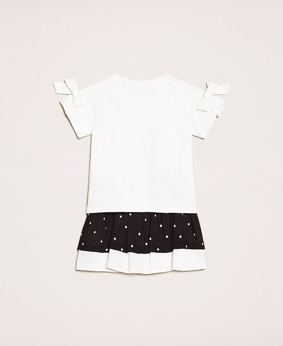 T-shirt with bows and polka dot skirt