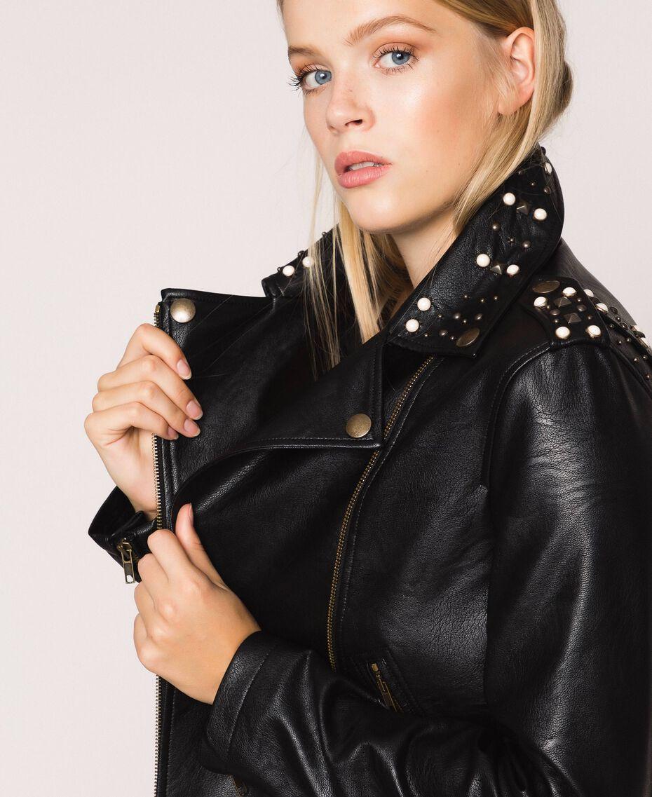 Chiodo in similpelle con borchie e perle Nero Donna 201TP241A-01