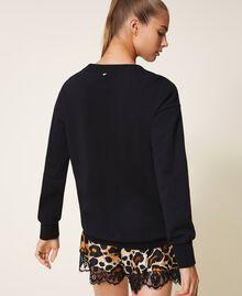 Sweatshirt mit Metallic-Schriftzug Schwarz Frau 202LL2MEE-03