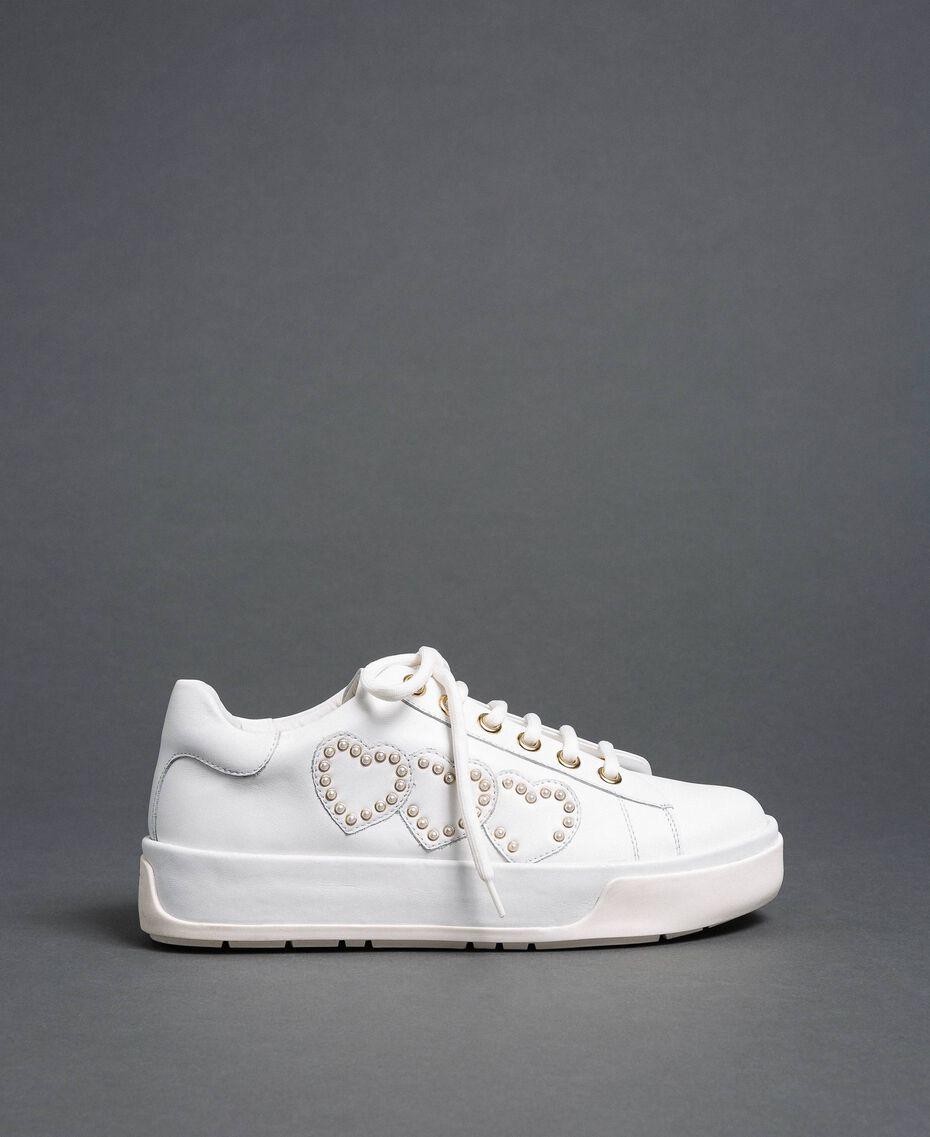 Sneakers aus Leder mit Herzen und Nieten Weiß Frau 192TCP01Y-03