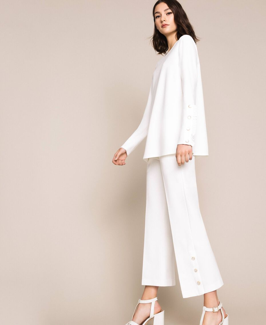 Trousers with frill and pearls Ivory Woman 201TP2103-02