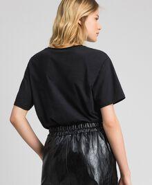 T-shirt avec imprimé papillon et logo Noir Femme 192TP2712-03