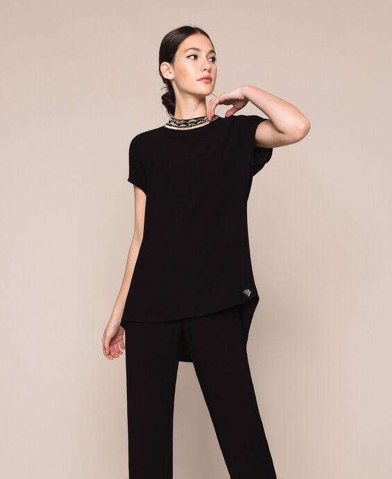 Asymmetric top with embroidery