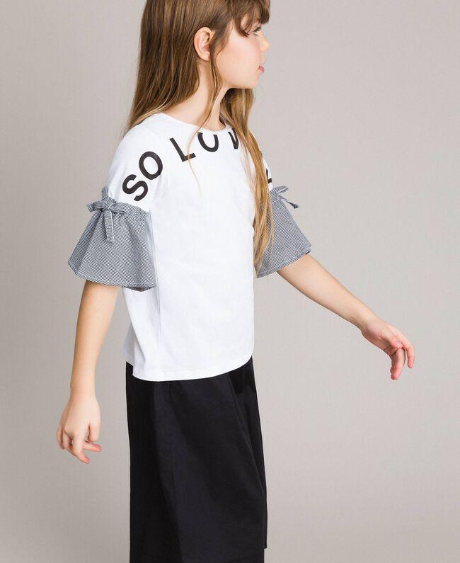 T-Shirt aus Jerseystoff mit Gingham-Volants Zweifarbig Optisch Weiß / Gingham Kind 191GJ2731-03