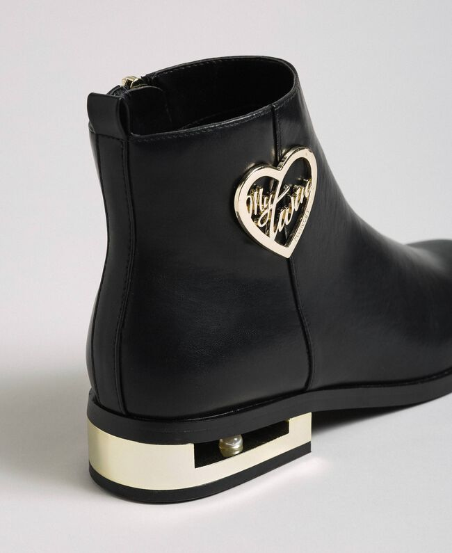 Logo ankle boots with decorative heel Black Woman 192MCP024-04