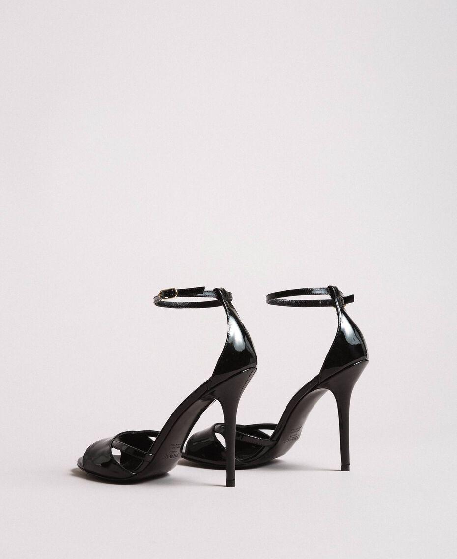 Leder-Sandalen mit Riemchen Schwarz Frau 191TCP10U-02