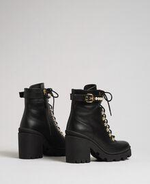 Schnürstiefelette aus Leder mit hohem Absatz und Perlen Schwarz Frau 192TCP01C-03