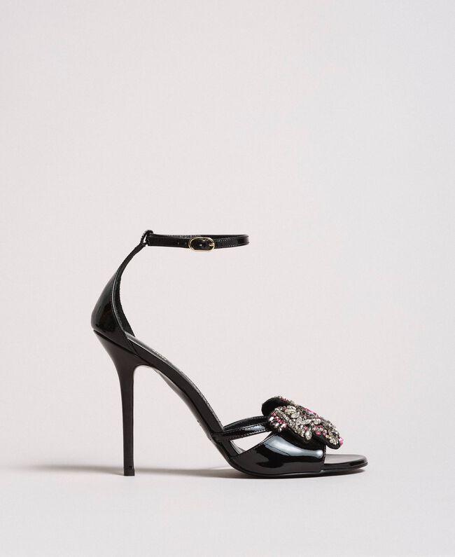 Sandales en cuir ornées d'un bijou papillon Noir Femme 191TCP104-01