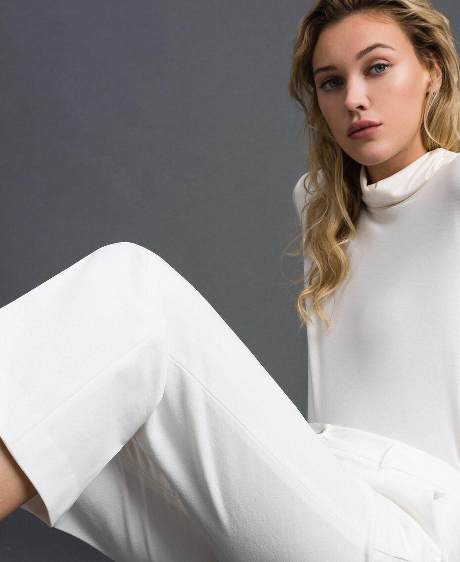 Расклешенные брюки Белый Снег женщина 192TP2092-05
