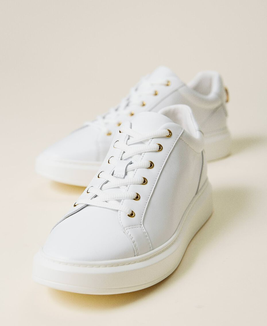Leather trainers with rhinestone logo White Woman 212TCP140-02