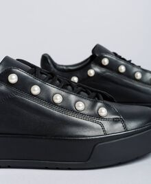 Leather sneakers with pearls Black Woman CA8PBU-04