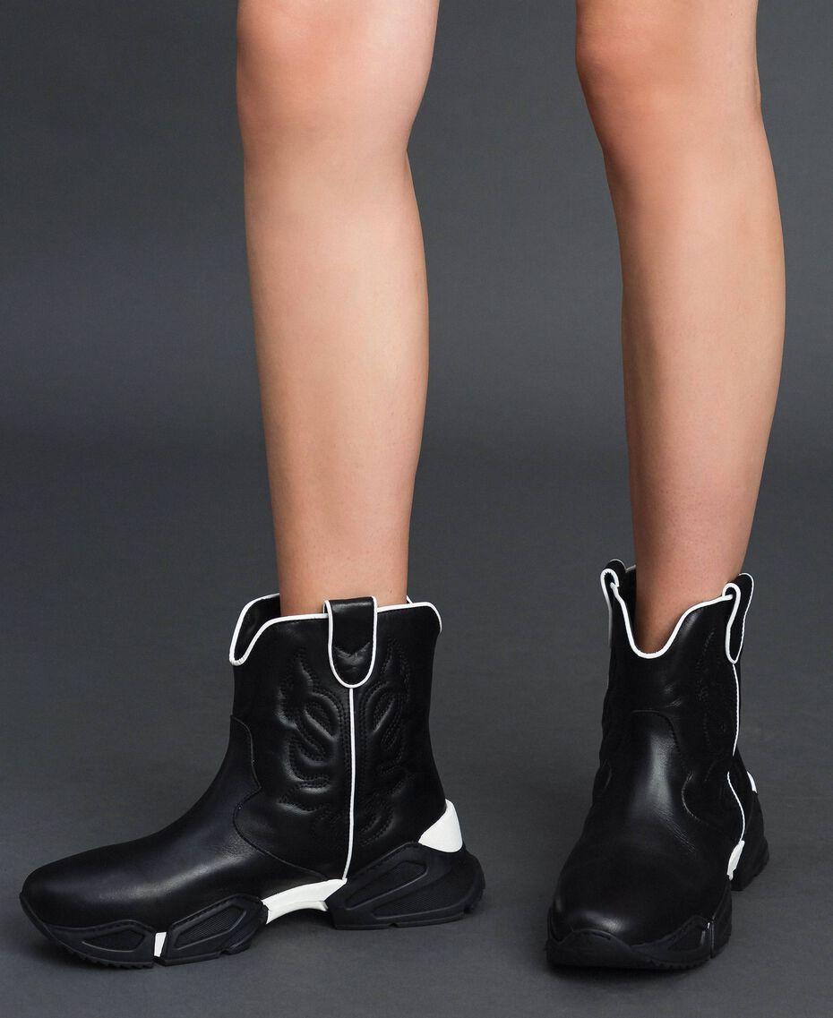 Hohe Cowboy-Sneakers mit Stickereien Schwarz Frau 192TCT114-0S