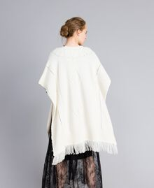 Knitted poncho with fringes White Snow Woman PA83LN-03